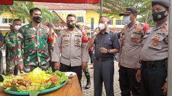 HUT TNI ke 76, Koramil 02 Terima Tumpeng dari Kapolsek Tarumajaya